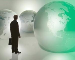 Businessman standing among globes